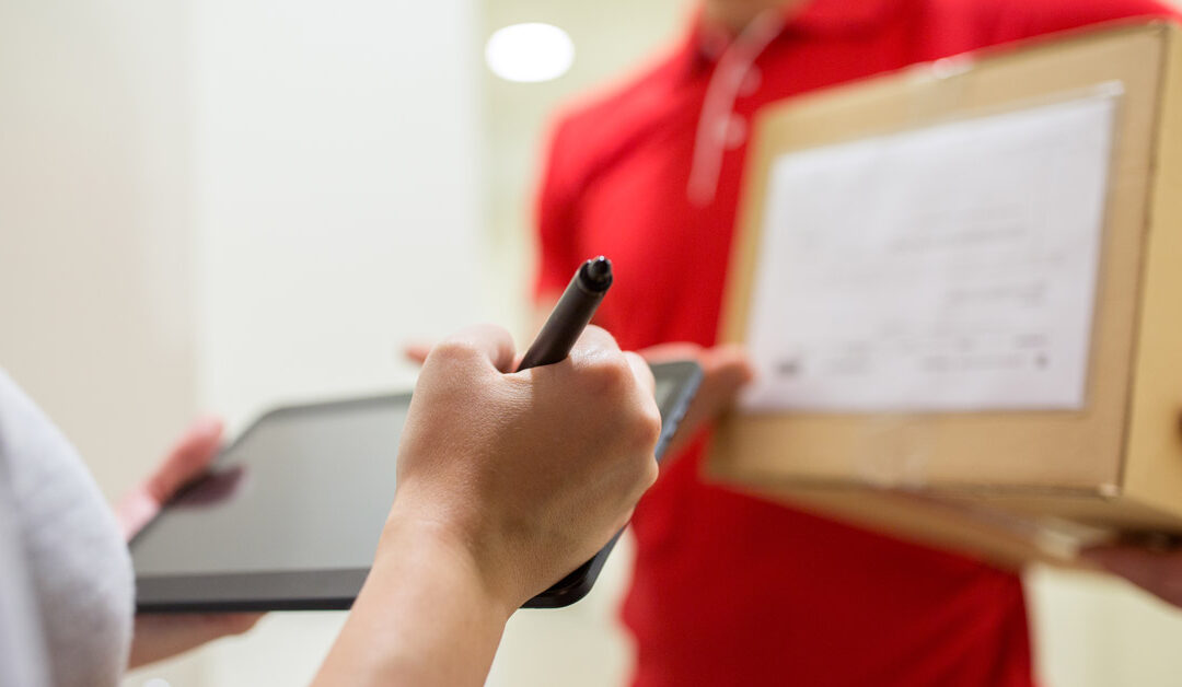 customer signing for a package delivery